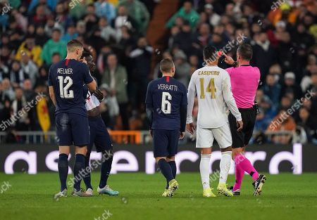Referee Artur Manuel Soares Dias overturns his red card presented to Goalkeeper Thibaut Courtois of Real Madrid after checking the VAR monitor in the first half
