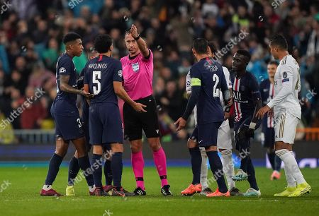 Marquinhos of Paris Saint-Germain reacts to Referee Artur Manuel Soares Dias as he overturns a red card presented to Goalkeeper Thibaut Courtois of Real Madrid and awards Real Madrid a free-kick after checking the VAR monitor.