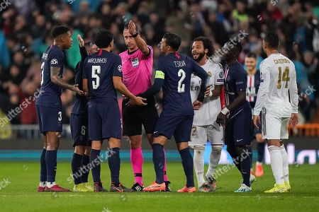 Marquinhos of Paris Saint-Germain and Thiago Silva of Paris Saint-Germain react to Referee Artur Manuel Soares Dias as he overturns a red card presented to Goalkeeper Thibaut Courtois of Real Madrid and awards Real Madrid a free-kick after checking the VAR monitor.