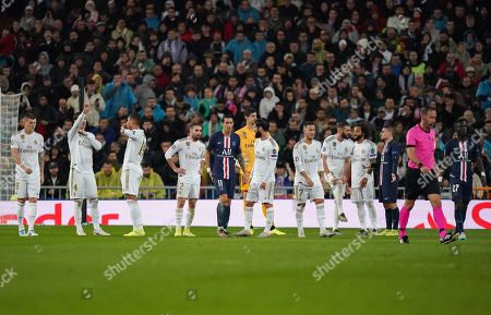 Toni Kroos, Sergio Ramos, Casemiro and Eden Hazard of Real Madrid react after Goalkeeper Thibaut Courtois of Real Madrid is presented a red card in the first half. The red card is subsequently overturned after a VAR check.