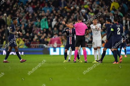 Marco Verratti of Paris Saint-Germain reacts to Referee Artur Manuel Soares Dias as he overturns a red card presented to Goalkeeper Thibaut Courtois of Real Madrid and awards Real Madrid a free-kick after checking the VAR monitor.