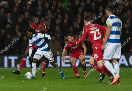 Eberechi Eze of QPR is surrounded by Sammy Ameobi of Nottingham Forest and Jack Robinson of Nottingham Forest