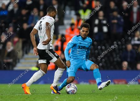 Denis Odoi of Fulham with Duane Holmes of Derby County defending