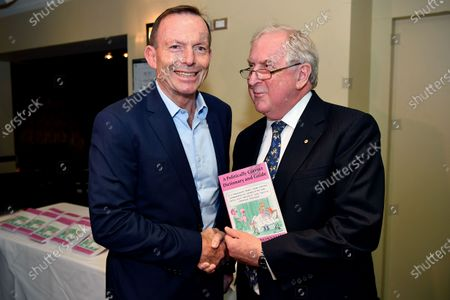Australian former prime minister Tony Abbott (L) greets author Kevin Donnelly during a book launch in Sydney, New South Wales, Australia, 25 November 2019. A Politically Correct Dictionary and Guide, by conservative commentator Dr Kevin Donnelly was launched pm the day in Sydney.