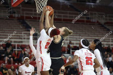 Wake Forest guard Alex Sharp (14) attempts shot at basket as St. John's guard Qadashah Hoppie (21) blocks her during an NCAA basketball game, in New York