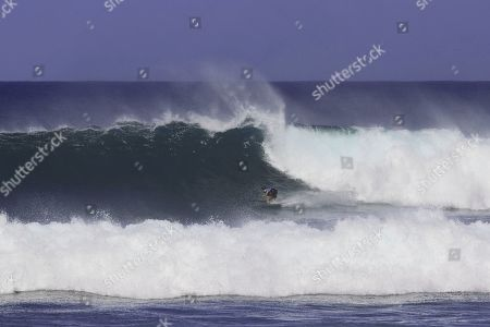 Stock Photo of Leonardo Fioravanti surfing during the WSL Hawaiian Pro Final.