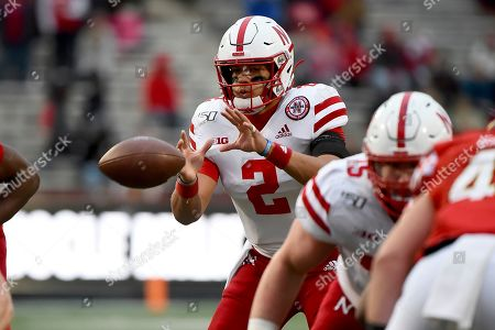 Nebraska quarterback Adrian Martinez (2) receives a snap during the first half of an NCAA college football game against Maryland, in College Park, Md