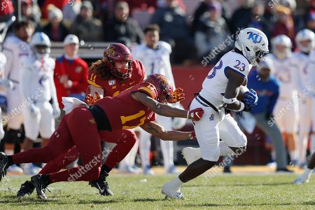 Stock Photo of Chase Allen, Richard Bowens, Kenny Logan. Iowa State tight end Chase Allen, left, and Iowa State defensive back Richard Bowens, center, chase down Kansas cornerback Kenny Logan, right, during the first half of an NCAA college football game, in Ames, Iowa