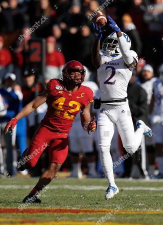 Marcel Spears, Daylon Charlot. Kansas wide receiver Daylon Charlot, right, brings down a reception as Iowa State linebacker Marcel Spears, left, defends during the first half of an NCAA college football game, in Ames, Iowa