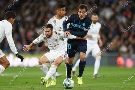 (L-R) Daniel Carvajal of Real Madridin action against Mikel Oyarzabal of Real Sociedad