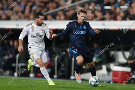 (L-R) Dani Carvajal of Real Madridin action against Nacho Monreal of Real Sociedad