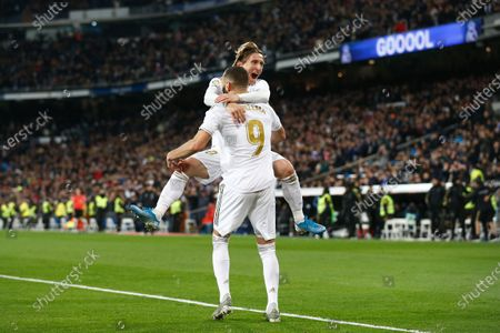 (L-R) Karim Benzemain action against Luka Modric of Real Madrid