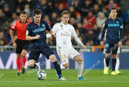 (L-R) Igor Zubeldia of Real Sociedadin action against Luka Modric of Real Madrid