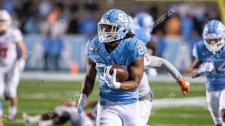 Stock Image of North Carolina's Josh Henderson (83) carries the ball during an NCAA college football game against Mercer in Durham, N.C