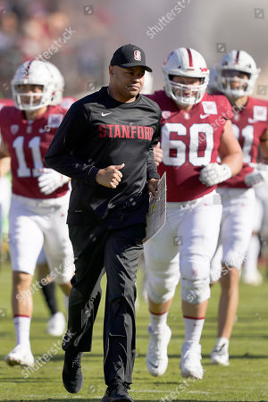 Name of person or event. Stanford Cardinal head coach David Shaw leads his team onto the field before an NCAA college football game against California in Stanford, Calif