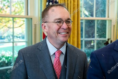 Acting White House Chief of Staff Mick Mulvaney stands in the Oval Office during the meeting of the US President and Prime Minister of Bulgaria, at the White House.