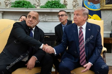 US President Donald Trump (R) and Prime Minister of Bulgaria Boyko Borisov (L) shaking hands while delivering remarks to members of the news media during their meeting in the Oval Office of the White House.