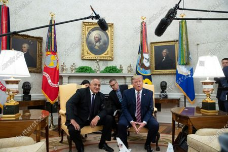 US President Donald Trump (R) and Prime Minister of Bulgaria Boyko Borisov (L) deliver remarks to members of the news media during their meeting in the Oval Office of the White House.