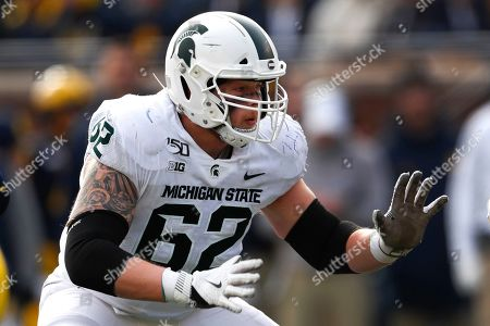 Michigan State offensive lineman Luke Campbell plays against Michigan in the second half of an NCAA college football game in Ann Arbor, Mich