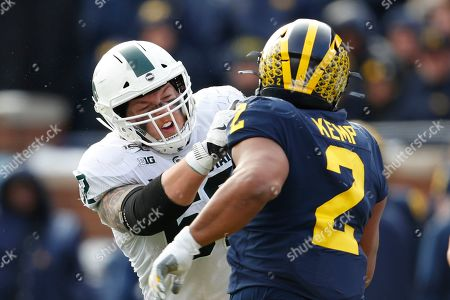 Michigan State offensive lineman Luke Campbell blocks Michigan defensive lineman Carlo Kemp (2) in the second half of an NCAA college football game in Ann Arbor, Mich