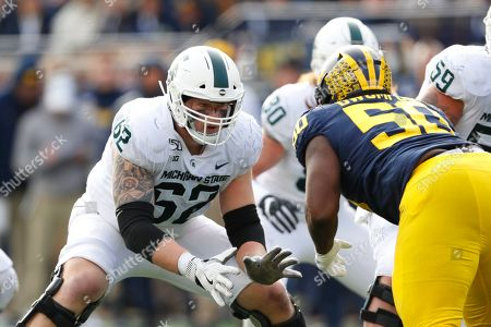 Michigan State offensive lineman Luke Campbell blocks against Michigan in the second half of an NCAA college football game in Ann Arbor, Mich
