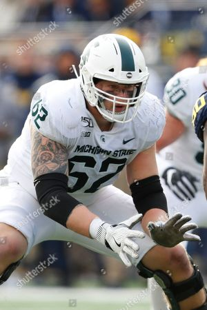 Stock Photo of Michigan State offensive lineman Luke Campbell blocks against Michigan in the second half of an NCAA college football game in Ann Arbor, Mich