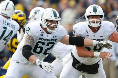 Michigan State offensive lineman Luke Campbell (62) blocks against Michigan in the second half of an NCAA college football game in Ann Arbor, Mich