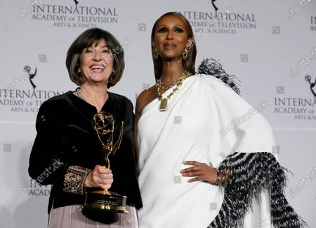 British-Iranian journalist Christiane Amanpour (L) holds the Directorate Award as she poses with Somali-American fashion model and actress Zara Mohamed Abdulmajid (R), at the 47th International Emmy Awards Gala at the New York Hilton hotel in New York, USA, 25 November 2019.
