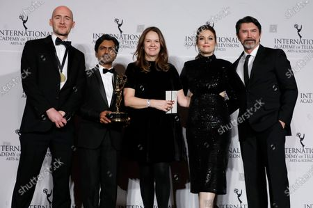 Stock Image of James Watkins, Indian actor Nawazuddin Siddiqui, executive producer Dixie Linder, US actress Bellamy Young and US actor Lou Diamond Phillips pose with the International Emmy award in the Drama Series category for McMafia during the New York Hilton hotel in New York, New York, USA, 25 November 2019.