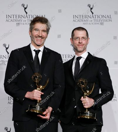 Game of Thrones creators David Benioff (L) and D.B. Weiss (R) pose with the Founders Award during the New York Hilton hotel in New York, New York, USA, 25 November 2019.