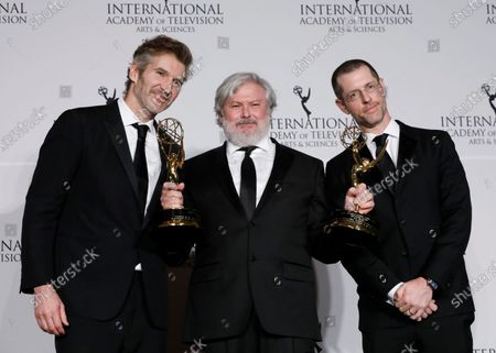 Game of Thrones creators David Benioff (L) and D.B. Weiss (R) pose with Northern Irish actor Conleth Hill after winning the Founders Award during the New York Hilton hotel in New York, New York, USA, 25 November 2019.