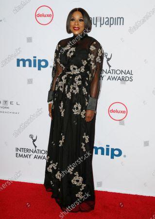Stock Photo of Mo Abudu, CEO of Ebonylife Media arrives for the 47th International Emmy Awards Gala at the New York Hilton hotel in New York, New York, USA, 25 November 2019.