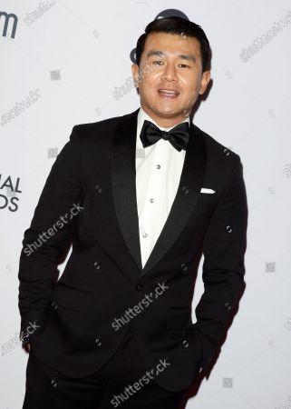 Ronny Chieng arrives for the 47th International Emmy Awards Gala at the New York Hilton hotel in New York, New York, USA, 25 November 2019.
