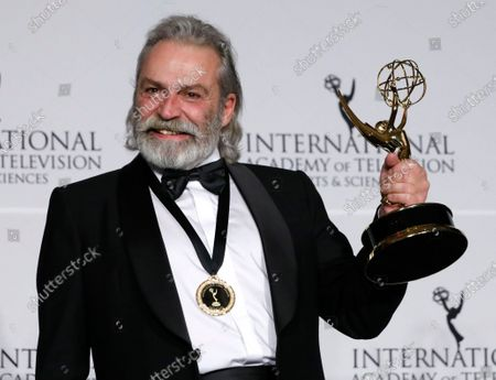 Stock Image of Haluk Bilginer holds the International Emmy for 'Sahsiyet' in the category of Performance by an Actor at the 47th International Emmy Awards Gala at the New York Hilton hotel in New York, USA, 25 November 2019.