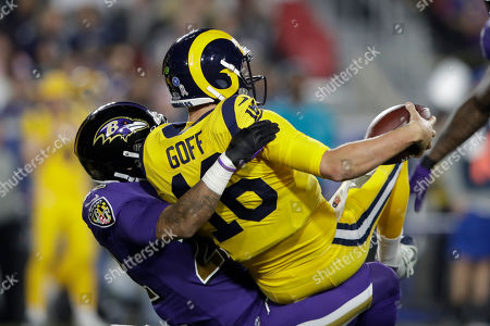 Baltimore Ravens cornerback Jimmy Smith sacks Los Angeles Rams quarterback Jared Goff during the first half of an NFL football game, in Los Angeles