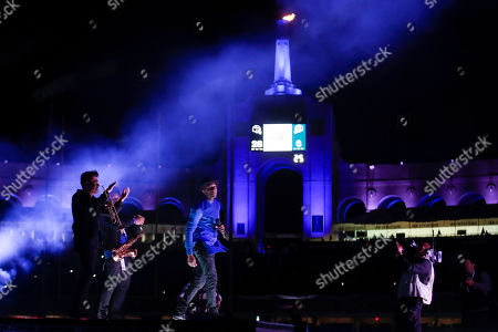 Aloe Blacc performs during half time at an NFL football game between the Los Angeles Rams and the Baltimore Ravens, in Los Angeles