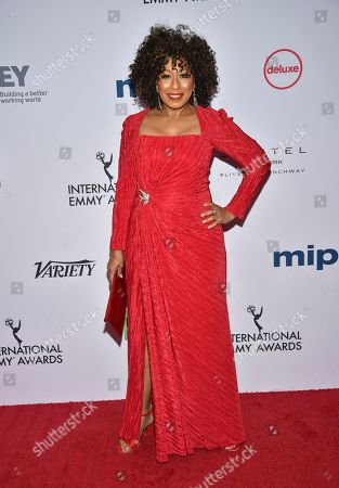 Tamara Tunie arrives at the 47th International Emmy Awards gala at the Hilton Hotel, in New York
