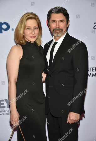 Stock Image of Yvonne Boismier Phillips, Lou Diamond Phillips. Yvonne Boismier Phillips, left, and Lou Diamond Phillips arrive at the 47th International Emmy Awards gala at the Hilton Hotel, in New York