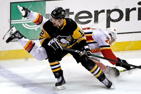 Editorial image of Flames Penguins Hockey, Pittsburgh, USA - 25 Nov 2019