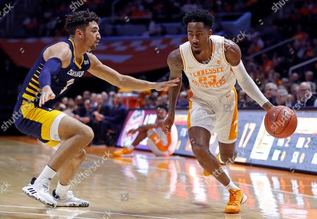 Tennessee guard Jordan Bowden (23) drives against Chattanooga guard Jonathan Scott (1) during the first half of an NCAA college basketball game, in Knoxville, Tenn