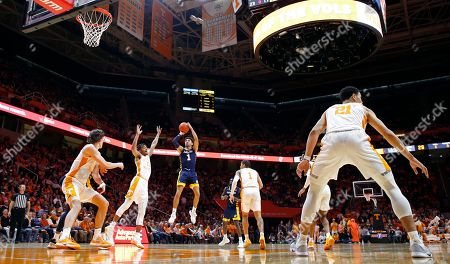 Chattanooga guard Jonathan Scott (1) shoots over Tennessee guard Lamonte Turner (1) during the second half of an NCAA college basketball game, in Knoxville, Tenn