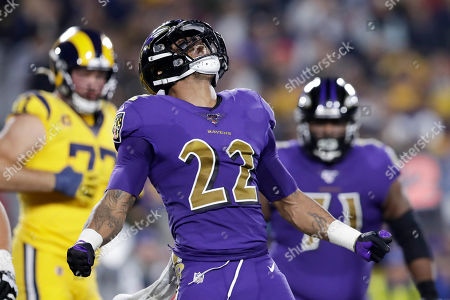 Baltimore Ravens cornerback Jimmy Smith celebrates after sacking Los Angeles Rams quarterback Jared Goff during the first half of an NFL football game, in Los Angeles