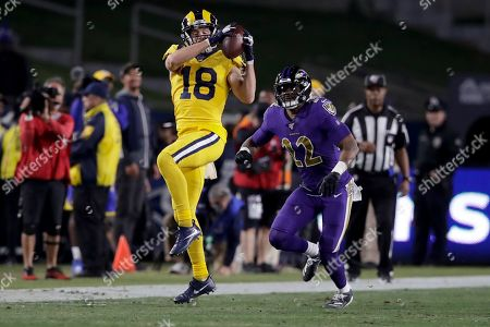 Los Angeles Rams wide receiver Cooper Kupp catches a pass in front of Baltimore Ravens cornerback Jimmy Smith during the second half of an NFL football game, in Los Angeles