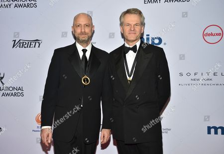 Michael Epstein, Peter Worsley. Michael Epstein, left, and Peter Worsley arrive at the 47th International Emmy Awards gala at the Hilton Hotel, in New York