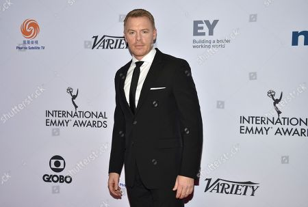 Diego Klattenhoff arrives at the 47th International Emmy Awards gala at the Hilton Hotel, in New York