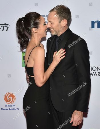 Stock Image of Catherine Reitman, Philip Sternberg. Catherine Reitman, left, and Philip Sternberg arrive at the 47th International Emmy Awards gala at the Hilton Hotel, in New York