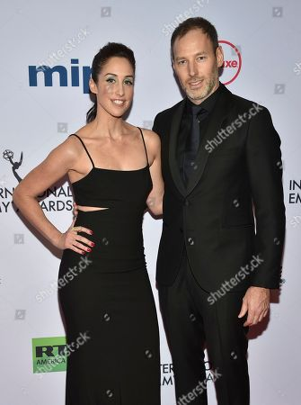 Stock Photo of Catherine Reitman, Philip Sternberg. Catherine Reitman, left, and Philip Sternberg arrive at the 47th International Emmy Awards gala at the Hilton Hotel, in New York