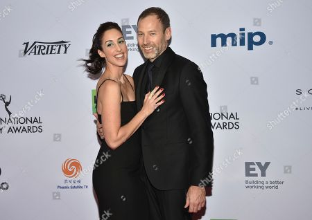 Stock Picture of Catherine Reitman, Philip Sternberg. Catherine Reitman, left, and Philip Sternberg arrive at the 47th International Emmy Awards gala at the Hilton Hotel, in New York