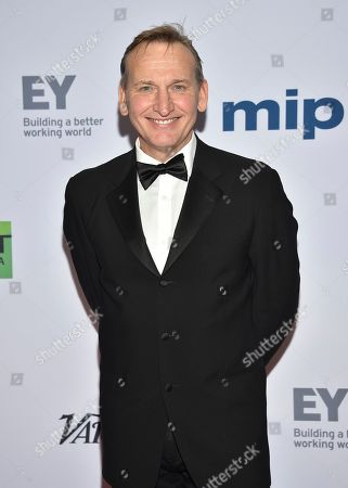 Christopher Eccleston arrives at the 47th International Emmy Awards gala at the Hilton Hotel, in New York