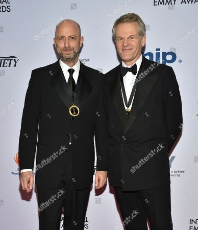 Michael Epstein, Peter Worsley. Director Michael Epstein, left, and producer Peter Worsley attend the 47th International Emmy Awards gala at the Hilton New York, in New York